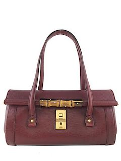 448a94a6b2c6 Gucci Leather Bamboo Bullet Bag. E. Consigned Designs. Login for Price