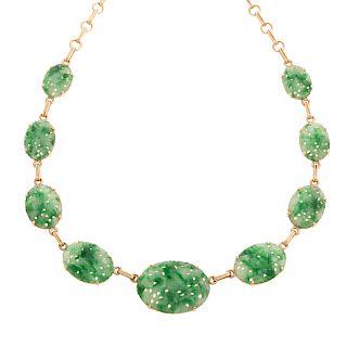A Ladies Carved Floral Jade Necklace in 14K