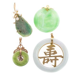 A Trio of Jade Pendants and a Jade Pin