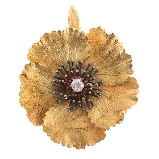 A Ladies Diamond Flower Brooch in 14K