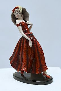 Goldscheider Art Deco figure of woman in patterned red dress
