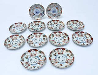 Twelve Japanese Imari scalloped plates