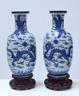 Pair Chinese 19th C. blue and white vases on carved rosewood stands