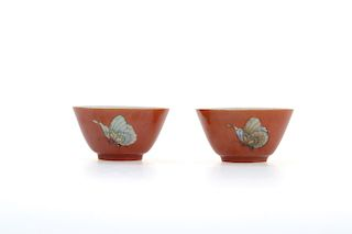 A PAIR OF CORAL RED GILDED BUTTERFLY CUPS