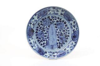 A CHINESE BLUE AND WHITE 'ROCK GARDEN' DISH