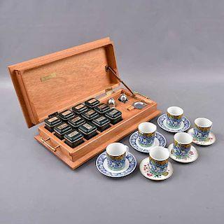 Caja de té en madera, platos base y tazas. Alemania y Singapur. Elaborado en porcelana Kaiser y HJ. Design.