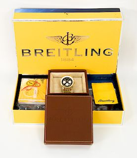 18 karat gold Breitling Chronometer Navitimer mens wristwatch with 18 karat band along with original boxes, books, and tag, model nu...