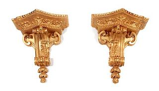 A Pair of French Giltwood Wall Brackets Height 19 x width 17 1/2 x depth 10 inches.