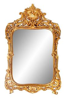 A Louis XV Style Giltwood Mirror Height 58 x width 38 inches.