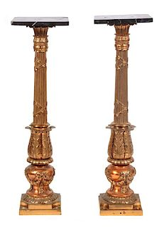 * A Pair of Gilt Metal and Black Marble Top Pedestals Height 39 inches.