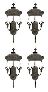 A Group of Four Cast Metal Wall-Mounted Lanterns Height 32 inches.