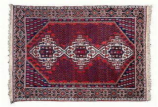 * A Persian Rug 83 1/2 x 59 1/2 inches.