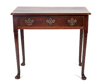 * A Queen Anne Oak Writing Table Height 28 x width 31 3/4 x depth 19 inches.