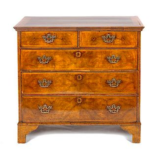 * A George II Walnut Chest of Drawers Height 36 1/2 x width 39 1/2 x depth 21 1/2 inches.