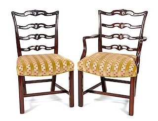 * A Set of Eight Chippendale Style Mahogany Dining Chairs Height 37 inches.