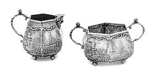 * A Dutch Silver Creamer and Sugar Set, , each decorated with nautical scenes.