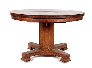 An Arts & Crafts Oak Round Extension Table Height 30 1/2 x diameter 48 inches.