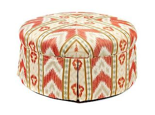 * A Modern Ikat Upholstered Ottoman Height 18 x diameter 36 1/2 inches.