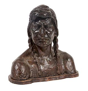 A Bronze Native American Bust Height 17 1/2 x width 17 1/2 x depth 8 inches.