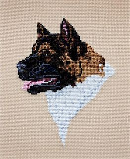 * A Cross-Stitch depicting an Akita 8 x 6 1/2 inches.