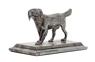 * An American Water Spaniel Cast Metal Figure Height 3 x width 5 1/4 x depth 2 5/8 inches.