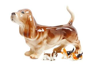 * A Group of Four Basset Hound Ceramic Figures Width of widest 11 1/2 inches.