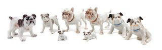 * A Group of Eight Porcelain Bulldogs Height of tallest 2 3/4 inches.