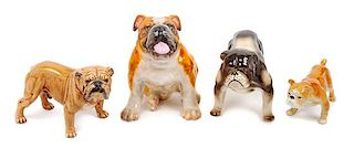 * A Group of Four Porcelain Bulldogs Height of tallest 6 1/2 inches.