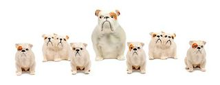 * A Group of Seven Beswick Porcelain Bulldogs Height of tallest 4 inches.