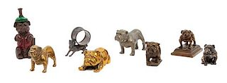 * A Group of Eight Bronze and Metal Bulldogs Height of tallest 5 1/4 inches.