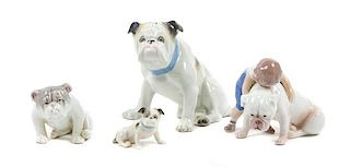 * A Group of Four Porcelain Bulldog Figures Height of tallest 5 1/4 inches.