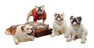 * A Group of Four Bulldog Figures Width of widest 12 1/2 inches.
