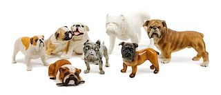 * A Group of Seven Porcelain and Bisque Bulldogs Width of widest 8 1/4 inches.