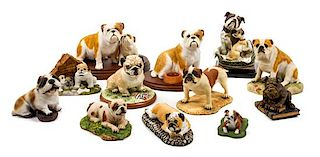 * A Group of Twelve Ceramic Bulldog Figures Width of widest 8 1/2 inches.