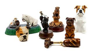 * A Group of Seven Bulldog Figures Width of widest 10 inches.