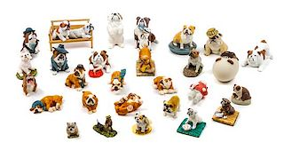 * A Group of Twenty-Eight Bulldog Figures Width of widest 4 5/8 inches.