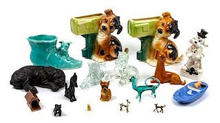 * A Group of Nineteen Bulldog Figures and Articles Height of tallest 14 3/4 inches.