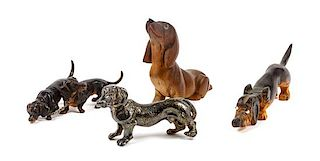 * A Group of Four Dachshund Figures Height of tallest 3 1/2 inches.