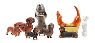 * A Group of Eight Dachshund Figures Height of tallest 8 1/4 inches.