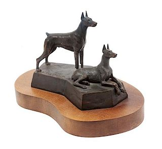 * A Bronze Doberman Sculpture Width of base 10 inches.
