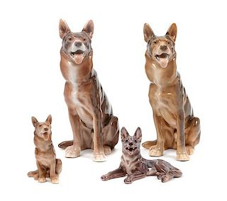 * A Group of Four Porcelain German Shepherds Height of tallest 8 3/4 inches.