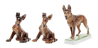 * A Group of Three Rosenthal Porcelain German Shepherds Width of widest 8 1/2 inches.
