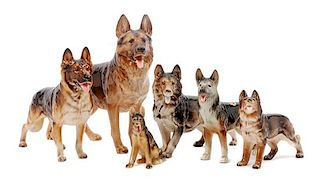 * A Group of Six Porcelain German Shepherds Width of widest 12 inches.