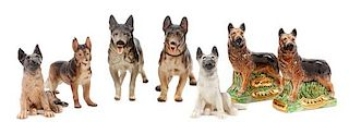 * A Group of Eight Porcelain German Shepherds Width of widest 9 1/4 inches.