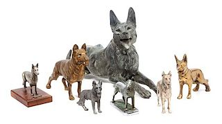 * A Group of Seven Metal German Shepherd Figures Width of widest 19 3/4 inches.