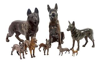 * A Group of Eight Bronze and Metal German Shepherds Width of widest 12 inches.