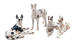 * A Group of Four Porcelain Great Dane Figures Height of tallest 10 1/2 inches.