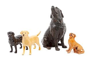 * A Group of Four Labrador Retriever Figures Height of tallest 10 1/2 inches.