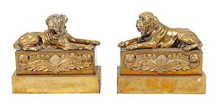 * A Pair of Brass Mastiff Chenets Width 11 1/2 inches.