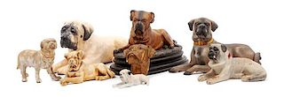 * A Group of Eight Mastiff Figures Width of widest 14 1/2 inches.